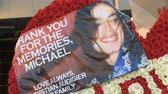WE LOVE YOU MICHAEL Tribute. Flower arrangement that reads WE LOVE YOU MICHAEL outside Michael Jacksons memorial service at LA LiveStaples Center in downtown Los Angeles, California on July 7th, 2009. Stock Footage