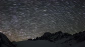 planety : Time lapse of the night sky with clouds and stars passing by behind mountains Pharilapche peak. Nepal, Full HD Wideo