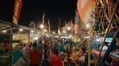 бампер : Indonesian crowd at travelling carnival with ferris wheels rides and snacks in Jogjakarta,, Indonesia