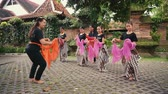 practising : Indonesian girls practicing Javanese dance lesson outdoors in Jogjakarta, Indonesia Stock Footage