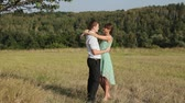 yellow : Young couple hugging on the yellow grass Stock Footage