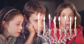 zsidóság : Kids watching hanukka candles burning