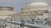 化石 : Large crude oil storage tanks in a huge refinery 動画素材