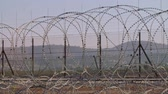 分離 : Border fence between Israel and West Bank. barbed wire electronic fence.