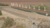 bölünmesi : Border fence between Israel and West Bank. barbed wire electronic fence.