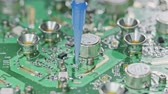 circuitos impresos : Close up of glue application on a large circuit board