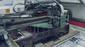 componente : Surface Mount Technology SMT Machine places components on a circuit board