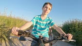 parques : POV of a young boy enjoying a bicycle ride on the rural countryside