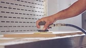 furnished : Slow motion of a worker polishing a cabinet door in a furniture factory Stock Footage