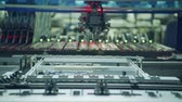 circuitos impresos : Automated SMT machine placing electronic components on a board.