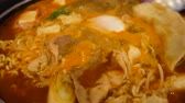 instante : Hot Korean noodle is boiling in a pot