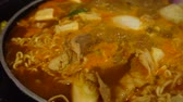 Hot Korean noodle is boiling in a pot