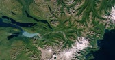 cartography : Very high-altitude overflight aerial of the mountains of Katmai National Park, Alaska. Clip loops and is reversible Stock Footage
