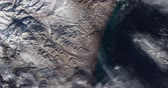 cartography : Very high-altitude overflight aerial of volcanic tundra, Kamchatka peninsula, Russia. Clip loops and is reversible
