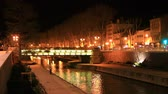 occitania : Quai on the edge of the Canal du Midi in the city of Narbonne at night, Aude in southern France Stock Footage