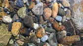 river bed : pebble background under the sea water Stock Footage