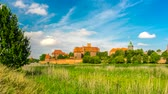 rendelés : 4K - timelapse. View of a medieval castle in Malbork with a reflection in the river.