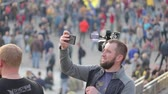 euromaidan : Kyiv, Ukraine 14 oct 2019. Guy making panorama with cellphone on protest against Minsk Protocol and Steinmeier Formula Stock Footage