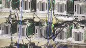 suíça : Row of bitcoin AntMiners set up on the wired shelfs.