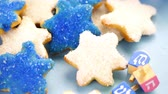 shin : Panning across Hanukkah white and blue stars hand frosted sugar cookies,