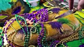 purple : Table decorated for Mardi Gras party.