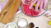 italiano : Ingredients for meatballs recipe on the table.