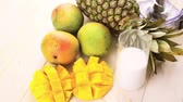 tropikal meyve : Fresh ingredients on the table to make smoothie with tropical fruits.