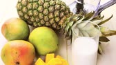 ananás : Fresh ingredients on the table to make smoothie with tropical fruits.