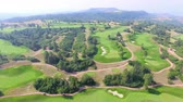 daniels : Aerial view of golf course surrounded by natural park.