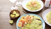 fokhagyma : Homemade corn risotto with roasted shrimp on dining table.