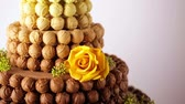trufas : Gourmet tiered wedding cake as centerpiece at the wedding reception.