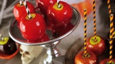 miniatura : Table with colored candy apples for Halloween party. Stock Footage