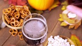 popping : Craft pumpkin beer in beer glasses with salty pretzels and popcorn.