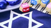 shin : Stitched Star of David on blue banner flag.