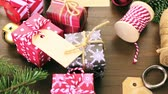 dekor : Wrapping assorted chocolates in small boxes for Christmas presents.