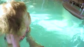 nemluvně : Toddler girl learning how to swim with her mother in indoor swimming pool.