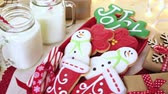 cooling wire rack : Home made Christmas cookies decorated with colorful icing.