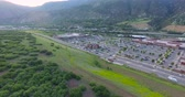 local : Glenwood Springs, Colorado, USA-June 20, 2015. Aerial view of main street at local shopping center. Vídeos