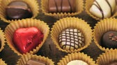 romance : Assorted chocolates on wood table.