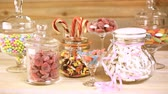 renk : Multicolored candies in glass candy jars. Stok Video