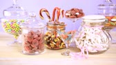 puha : Multicolored candies in glass candy jars. Stock mozgókép