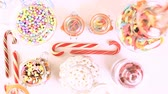 mix : Multicolored candies on a white table. Stock Footage