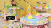 кексы : Dessert table with Easter cake decorated with traditional Easter marshmallow chicks.