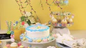 chalk board sign : Dessert table set with cake and cupcakes for Easter brunch.
