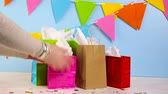 saco : Gift bags at the kids Birthday party on the table. Stock Footage