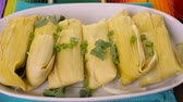 стол : Home made tamales on serving plate on the party table. Стоковые видеозаписи