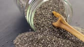 ingrediente : Healthy Chia seeds in glass jar close-up.