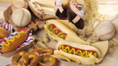арахис : Baseball party food with balls and glove on a wood table. Стоковые видеозаписи