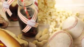 cusine : Baseball party food with balls and glove on a wood table. Stock Footage