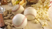 luva : Baseball party food with balls and glove on a wood table. Vídeos